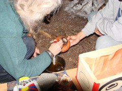 Cynthia Jurs and Evon Peter Sealing the Earth Treasure Vase with wax before it is buried in Arctic Alaska