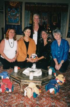women with vase in kiva
