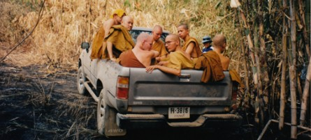 Thai Buddhist monks piled in a truck for the rugged treck to the monastary in Dtao Dum