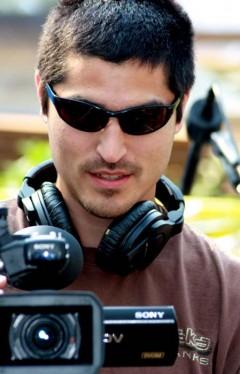 Odin Peter Raboff, a local indigenous filmmaker, filming at the Earth Treasure Vase ceremony in Alaska