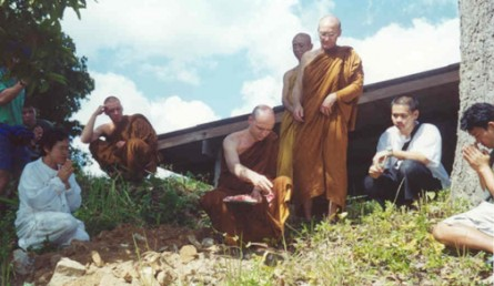 The Thailand Earth Treasure Vase is ceremonially buried on a vista in Dtao Dum by monks and people in the community