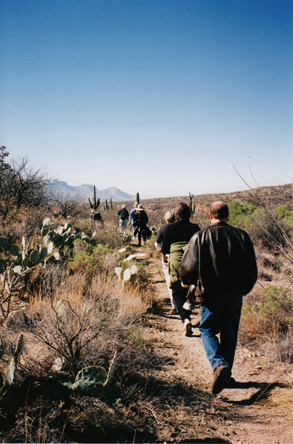 Group walking through desert to ceremony ground