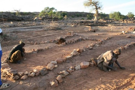 The Dogon divination begins with an intricate design of sticks and lines drawn in the earth