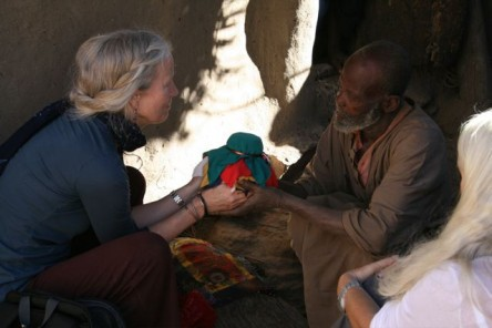 Cynthia Jurs and the Dogon elder share their prayers and blessings for the earth treasure vase