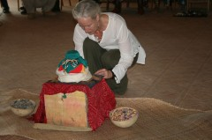 Cynthia Jurs prepares the earth treasure vase for the final offering ceremony